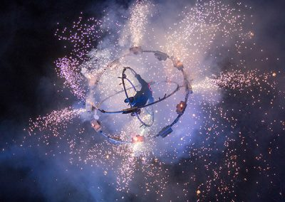 Spinning performer in aerial fireball at Calgary Stampede ©JMillar Tilt Creative performance photography